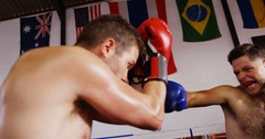 Two boxers practicing in boxing ring Stock Footage