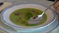 Organic Broccoli Soup - Top View of Man Han Eating Soup with a Spoon Stock Footage