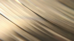 Macro shot of a vinyl sic spinning with its retro grooves. Filmed in a nice Stock Footage