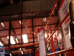 Pair of boxing gloves hanging on boxing ring Stock Footage