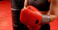 Confident female boxer performing boxing stance Stock Footage