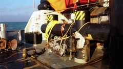 Deck of tug in sea with huge bollard and mooring and cables on sunny frosty Stock Footage