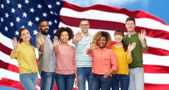 International people waving hand and american flag Stock Photos