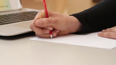 Writing drafts on paper with feather pen Stock Footage