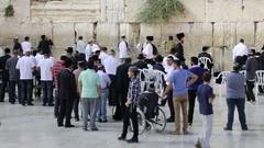 Jewish public pray at the Kotel Stock Footage