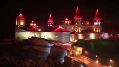Old castle at night, stone fortress in Kamianets-Podilskyi city, western Ukraine Stock Footage
