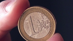Close up of male hand holding one euro coin Stock Footage