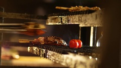 Cooking meat, tomatoes and mushrooms on grill at the kitchen with flame Stock Footage