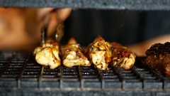 Cooking meat on grill at the kitchen with flame Stock Footage