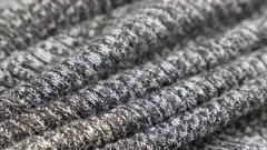Shallow DOF modern knitwork of jumper fabric Stock Footage