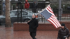 Man Waiving An Upside Down American Flag Stock Footage