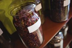 Close-up of spice jars arranged on shelf Stock Photos