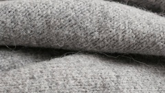 High quality modern gray women sweater knitting texture close up Stock Footage