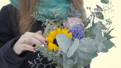 Close-up, holding a bouquet of flowers on a winter day Stock Footage