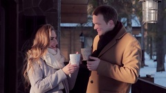 Happy Valentine's day beautiful young couple with hot tea in the cottage Stock Footage