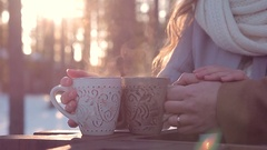 Close-up of hands of loving couple with hot drink on Valentine's Day on sunset Stock Footage