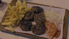 Woman eating meat patties with potatoes and vegetables Stock Footage