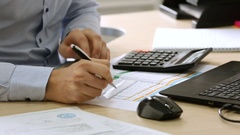 Engineering-technical worker. Office worker studying business papers. HD Stock Footage