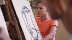 Young Artist Drawing In College Young Man Painting At School Stock Footage