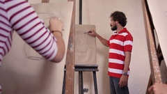 Man At Work As Teacher In Art School With Students Stock Footage