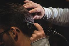 Close-up of man getting his hair trimmed with trimmer Kuvituskuvat