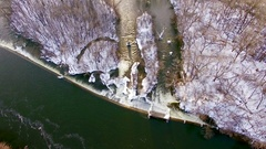 Aerial view of icy, snowy river flowing through wilderness Stock Footage