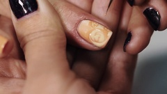 Female beautitian hand draw curls on beige nail in beauty shopwhite table Stock Footage