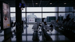 People commuting in modern airport terminal slowmotion cinematic newsworthy Stock Footage