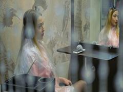 Blonde girl in transparent crystal pendants Stock Footage