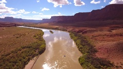 Aerial amazing shot of rafting boats on the calm desert river in utah Stock Footage
