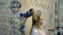 Barber, hair dye, blonde sitting in the beauty salon. Hairdresser dye the hair Stock Footage