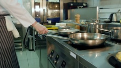 Chef tossing and stirring dishes on the stove Stock Footage