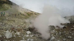 Natural volcanic hot springs erupting clouds of hot steam and gas Stock Footage