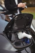Close-up of electric car getting charged Stock Photos