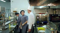 Head cook talking to his trainne and giving him task Stock Footage