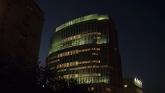 LOW ANGLE VIEW: Outstanding office building in New York city center at night Stock Footage