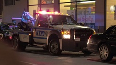 CLOSE UP: NYPD police car with lights on parked on the street in front of a shop Stock Footage