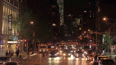 CLOSE UP: Diving along the 6th ave at night in lit New York city streets Stock Footage