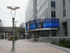 People walking near Parlamentarium European Parliament in Bruxelles Stock Footage