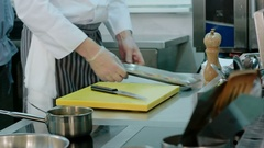 Male cook's hands stirring sauce and chopping garlic Stock Footage