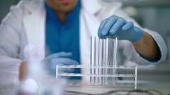 Empty test tubes in rack. Lab worker preparing laboratory glassware Stock Footage