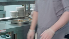 Male chef putting cooked shrimps on a serving dish Stock Footage