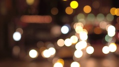 BOKEH: Colorful blurry traffic lights and automobile headlights in downtown city Stock Footage
