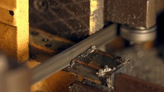 Metal bar being cut by swivel metal cutting band saw. Stock Footage