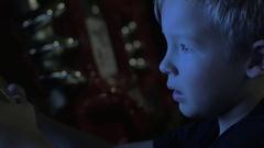Child shooting on amusement machine Stock Footage