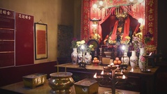 Interior of Man Mo Temple in Hong Kong with incense offerings Stock Footage
