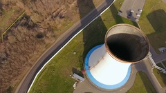 Camera flying above the chimney of the heat power plant. 4K Stock Footage