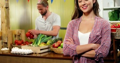 Portrait of beautiful woman standing at vegetable counter Stock Footage