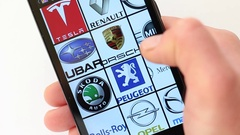 Popular Car Brands and Car Logos on smartphone screen Stock Footage