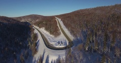 Aerial view of hairpin bends of Ural mountain pass in Russia on sunny summer day Stock Footage